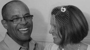 Jim and Lori King laughing at wedding May 2012