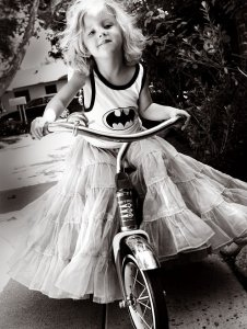 Bat girl on a bike