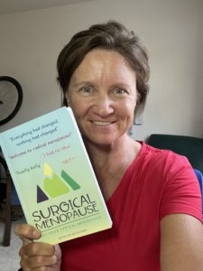 Lori Ann King, Author holding book: Surgical Menopause ~ Not Your Typical Menopause